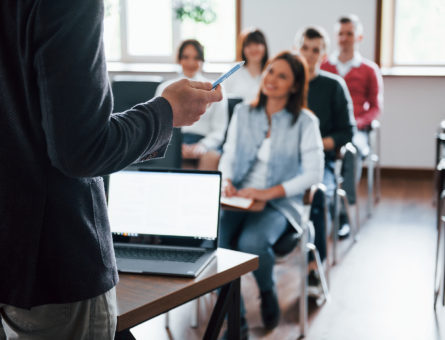 everyone-is-smiling-listens-group-people-business-conference-modern-classroom-daytime